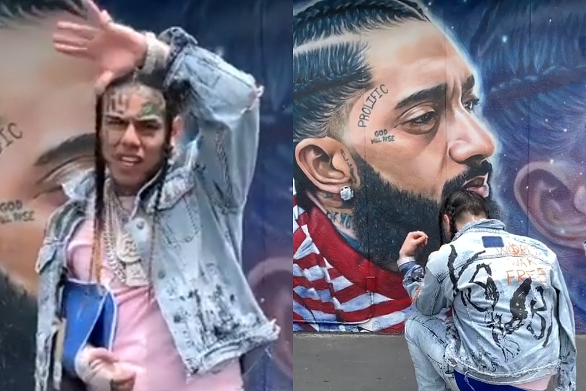 6ix9ine Gets Dragged After Kneeling in Front of Nipsey Hussle Mural